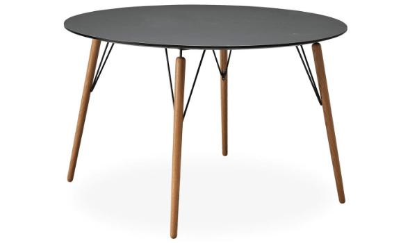 Air rundt spisebord i sort og eg nordisk stil i luftigt design