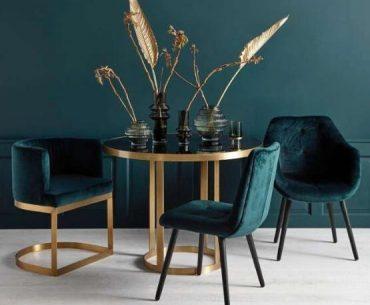 Golden rundt spisebord elegant og dekadent på den fineste måde